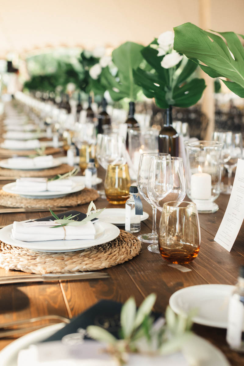 Long table filled with glasses and wedding breakfast wine and champagne