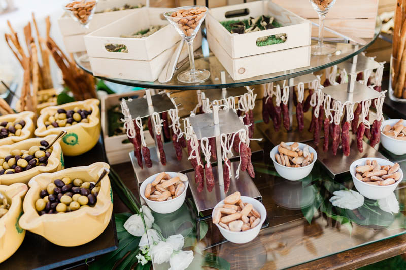 bowls of olives and breadsticks on the table at wedding reception