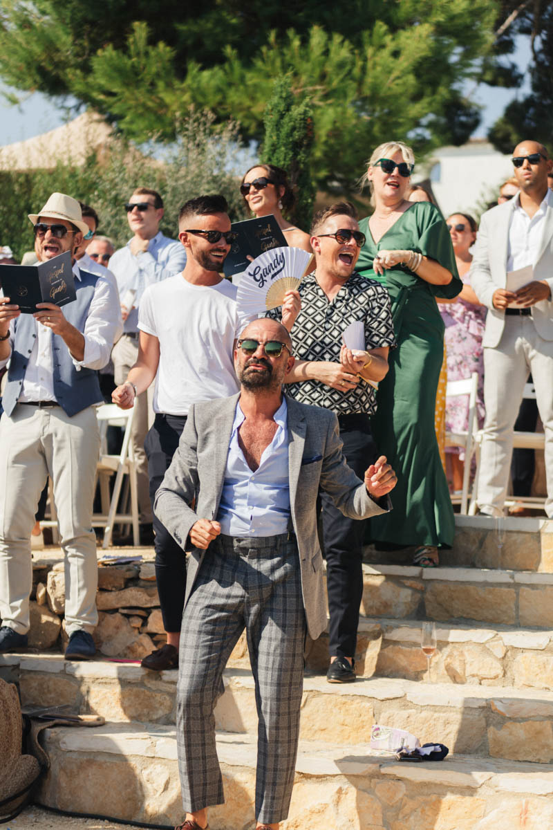 Man dancing on the stone staircase at wedding ceremony
