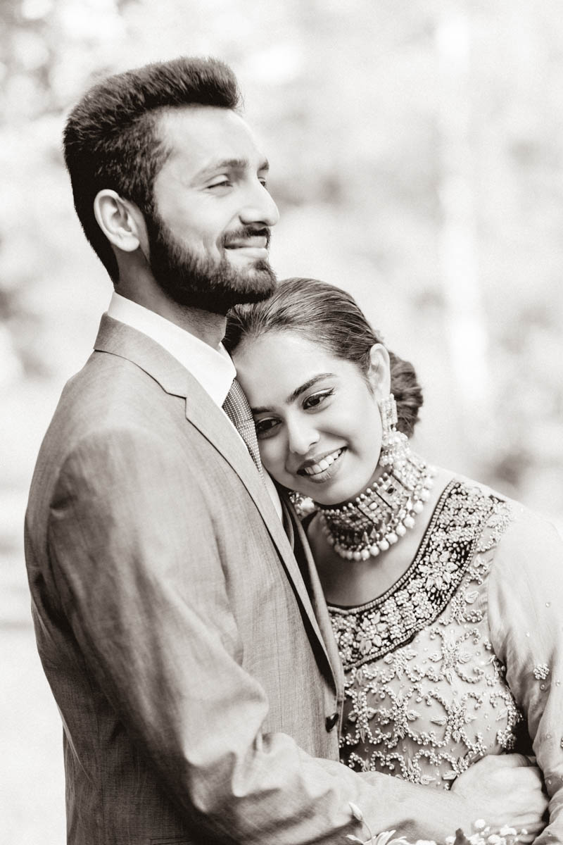 timeless portrait of couple hugging each other wearing formal Indian dress on their engagement session