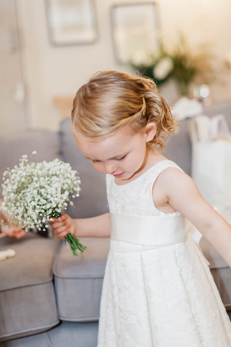 Flower girl holding a Bunch of gypsophelia flowers