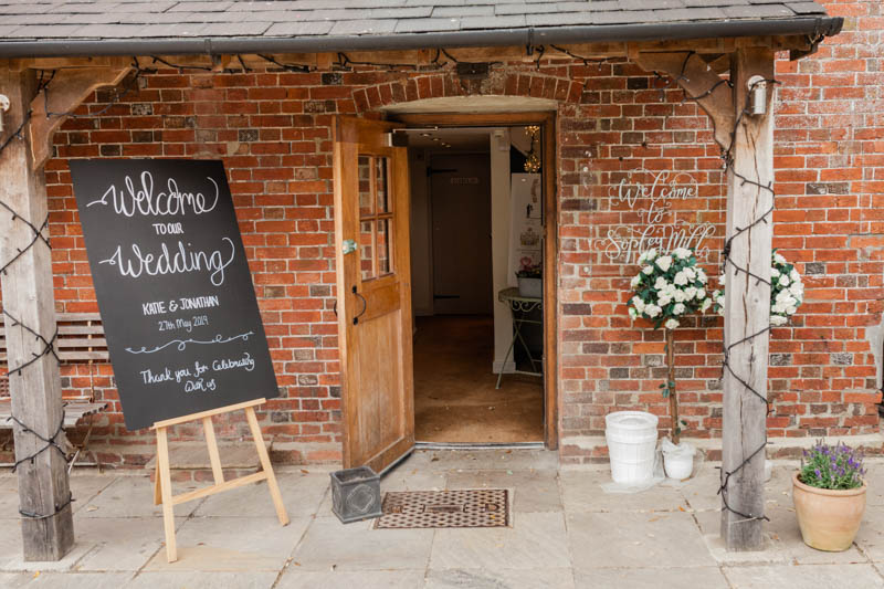 Wedding welcome sign at the entrance to the ceremony room at Sopley Mill in Dorset