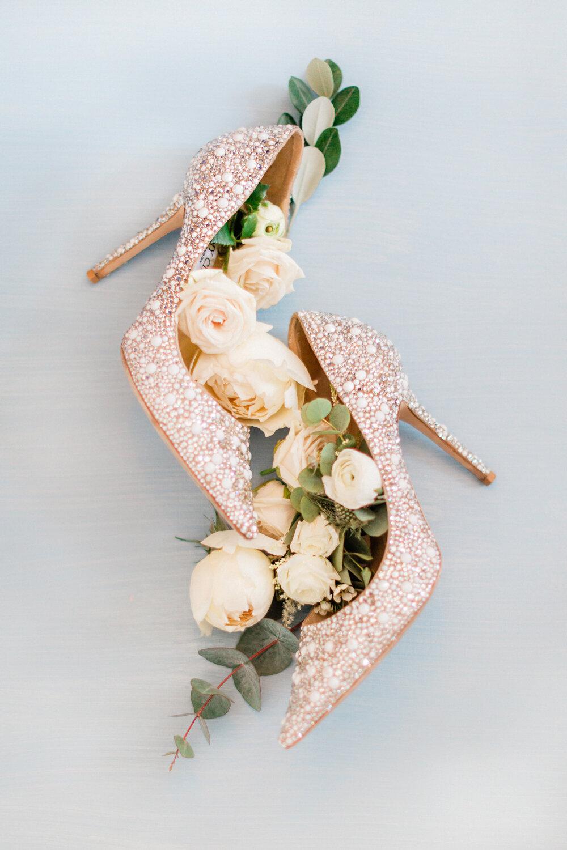 Jimmy Choo luxury wedding shoes adorned with luxury white roses