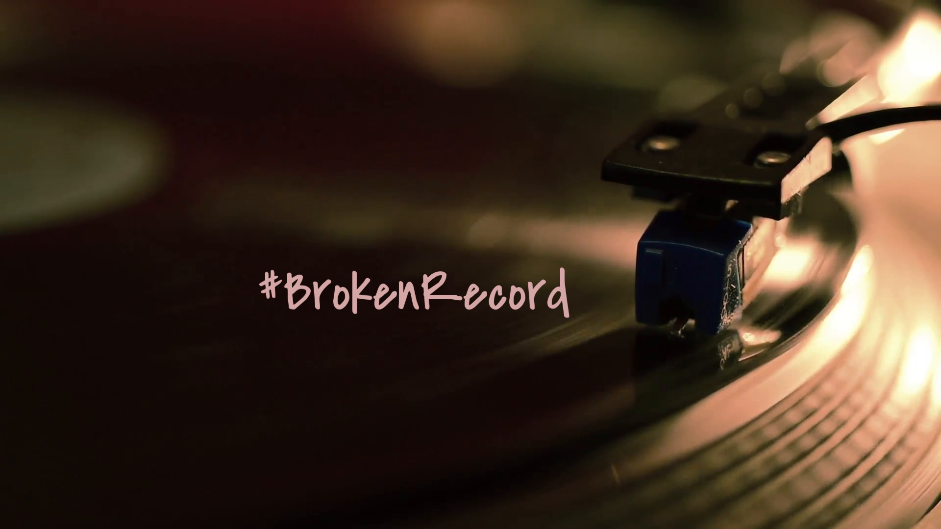 a-vintage-record-player-plays-a-vinyl-record-dolly-shot-pans-left-to-right-to-reveal-a-close-up-shot-of-a-hand-placing-the-needle-on-the-record_noblpm1ol__F0010.png