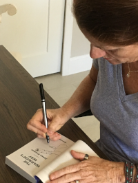 Bestselling author, Jenna Kernan, autographing her new release, THE WARRIOR'S WAY, from Harlequin Intrigue