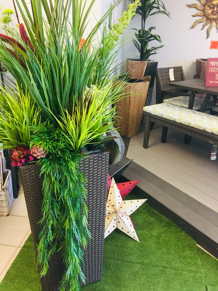 Forever Florals vs Planting Annuals in your Outdoor Planters - No matter how large or small your space is, having greenery or mixed floral planters will not only make your space warm and inviting, it can add privacy and other design elements to your space.