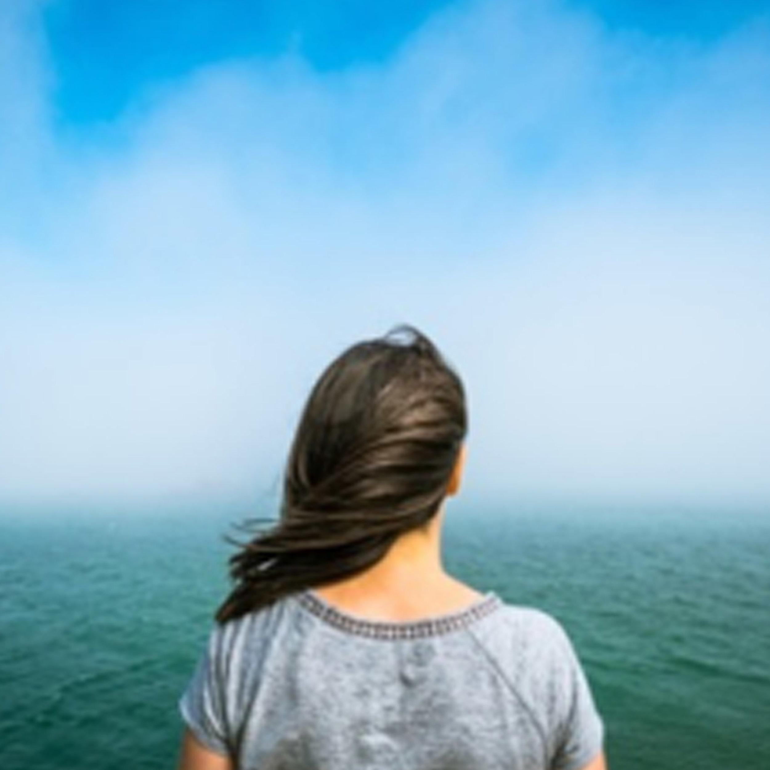 Woman-Looking-at-Sea.jpg
