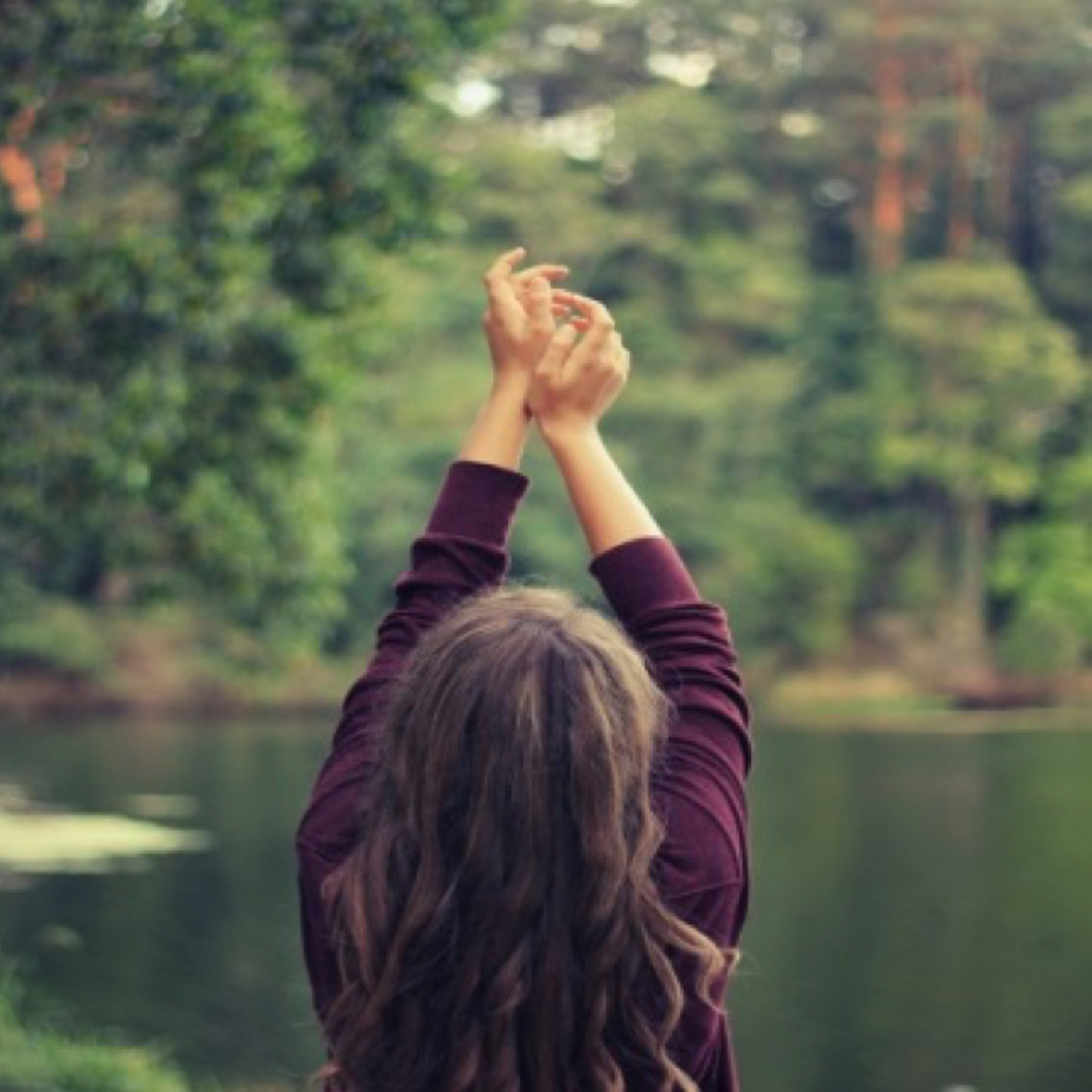 Woman-raising-hands.jpg