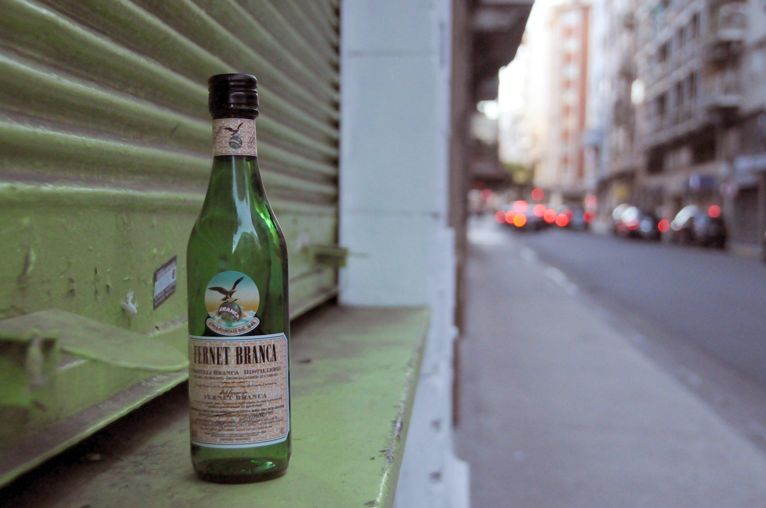 Empty Fernet bottle on the street. Photo by Allison Yates.