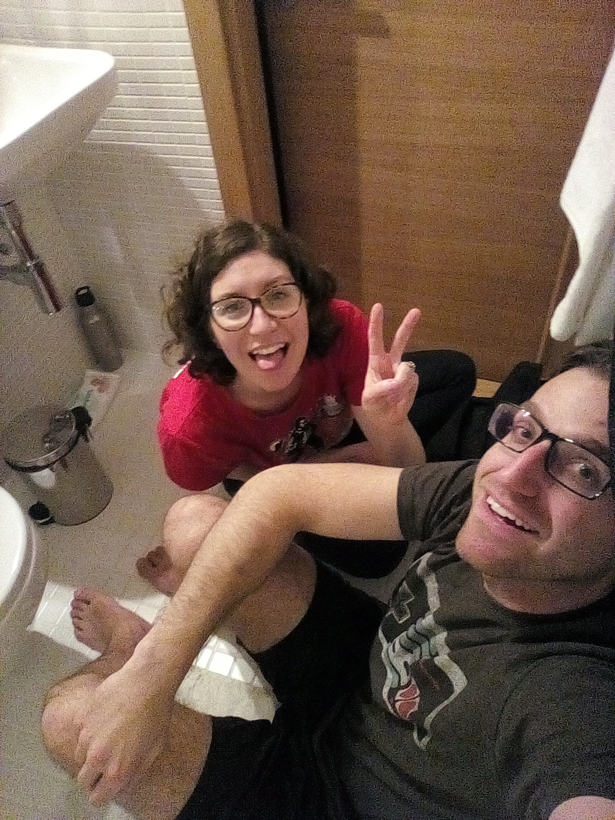 Hiding in the tiniest hotel bathroom ever while waiting for Baby ISO to fall asleep.