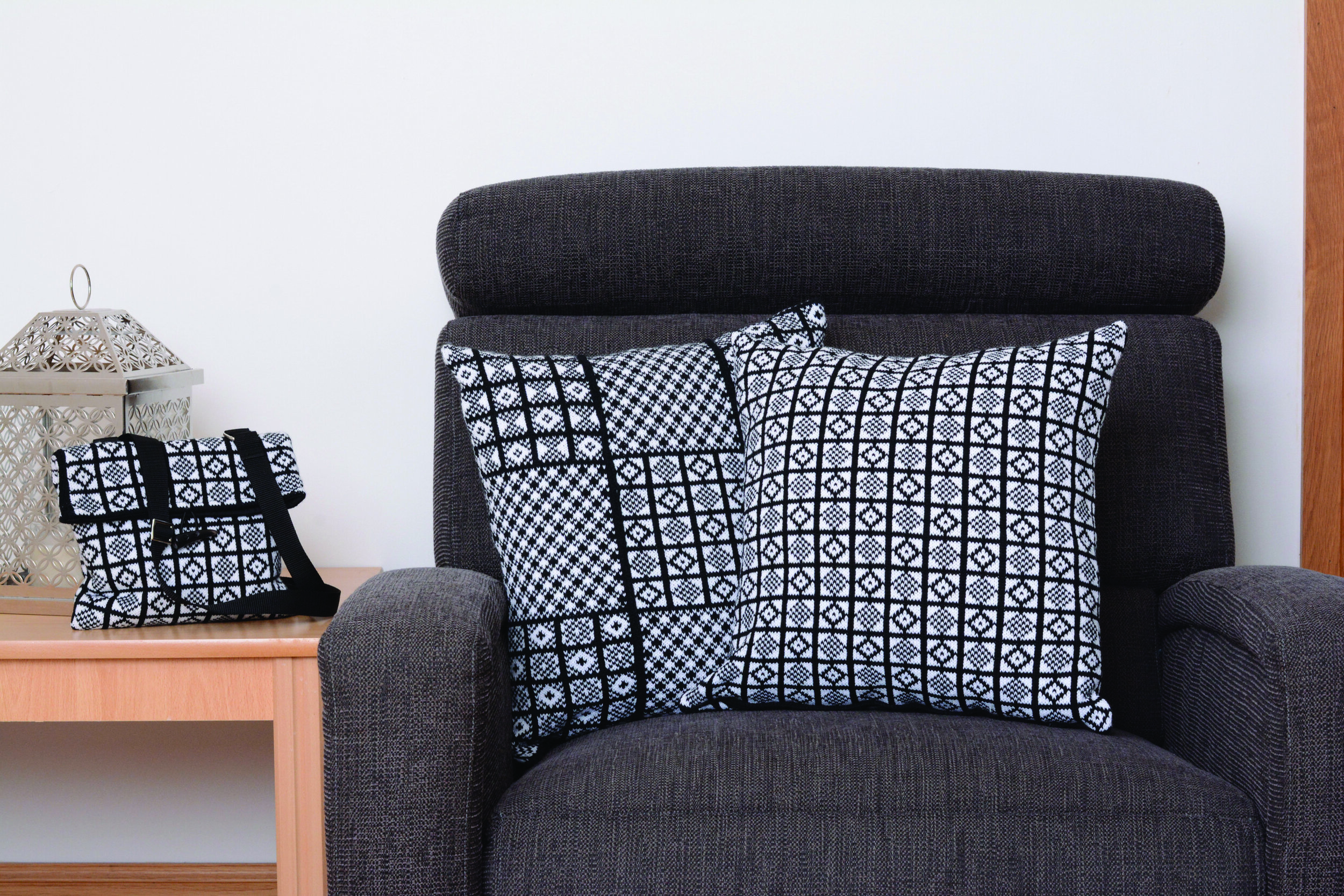 (L) Handmade Duke pattern bag in black and white.  (M) Black and white acrylic machine knitted Sanquhar Pattern Patchwork cushion. (R) Black and white acrylic machine knitted Sanquhar Pattern Duke cushion.