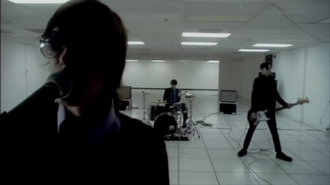Still from the Obstacle 1 music video off Turn on the Bright Lights