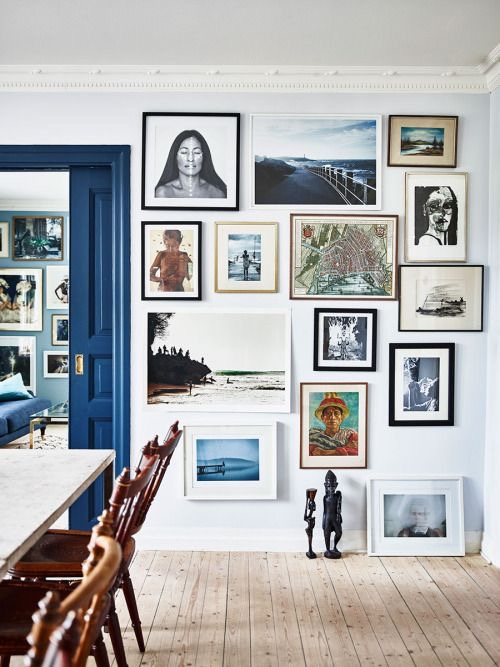 Go as big and bold with your gallery wall as your core style allows. Propping art against the wall and displaying sculpture on the floor? That's fine too!
