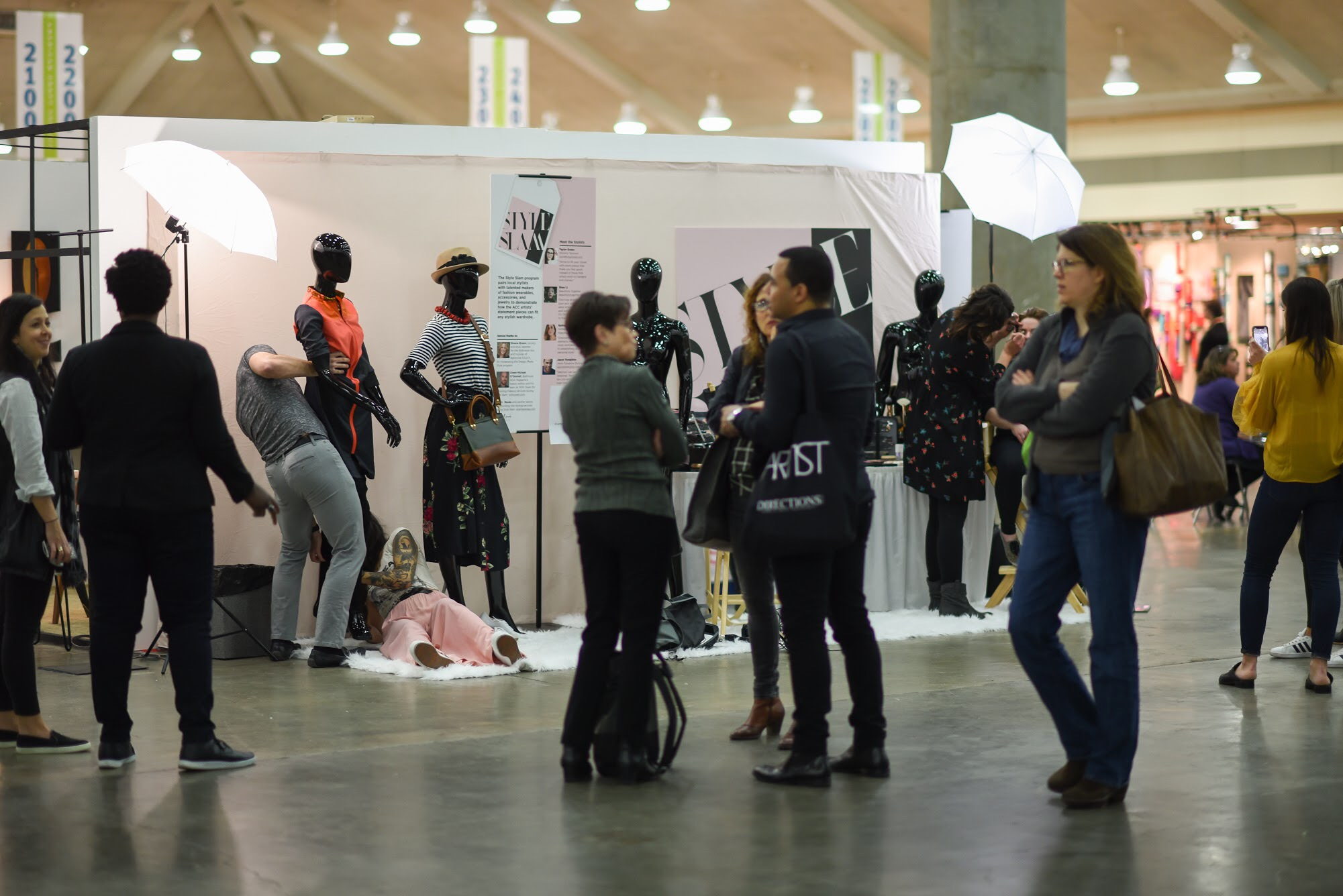 The Style Slam booth. Please note me lying on the ground attempting to put pants on my mannequin. I would later change the outfit because it didn't translate as well as it did on an actual model.