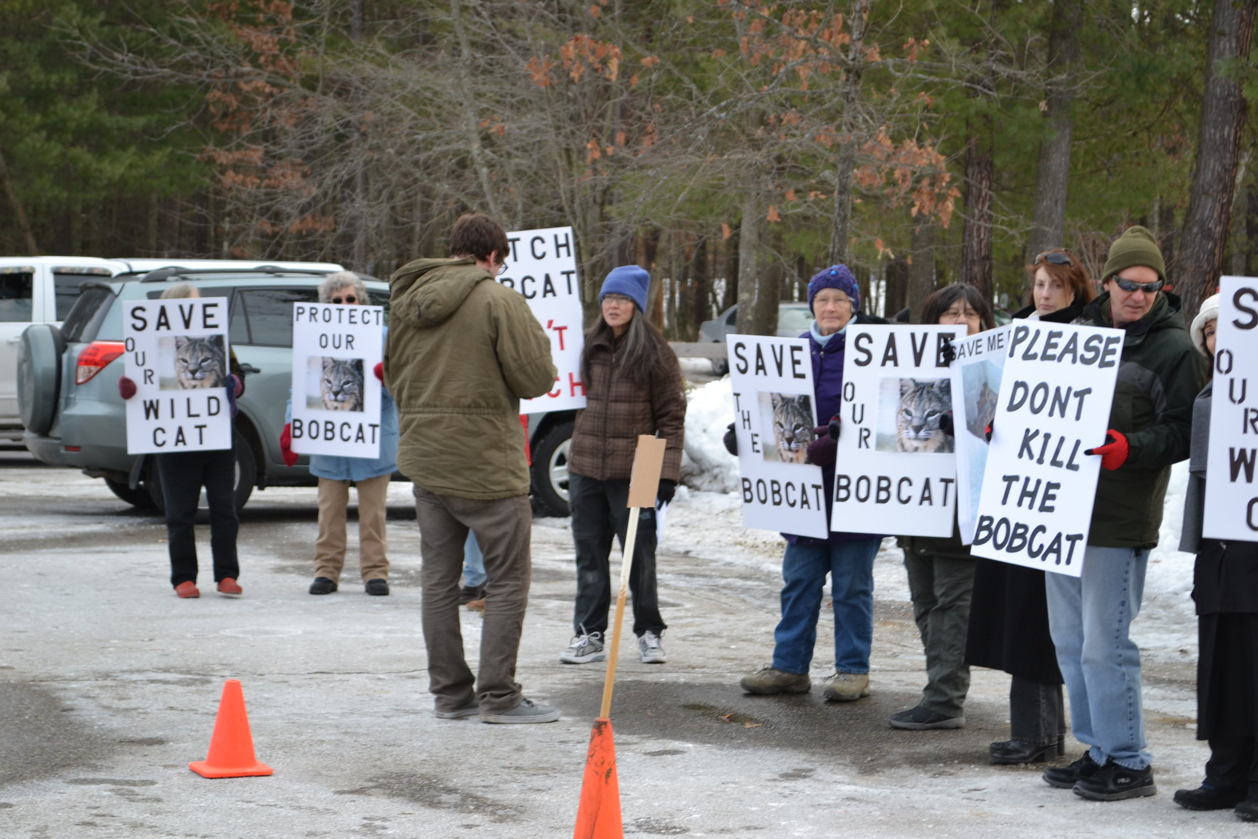 Protestors stand outside NH Fish & Game Headquarters during a NHFG Commission meeting on bobcat management.