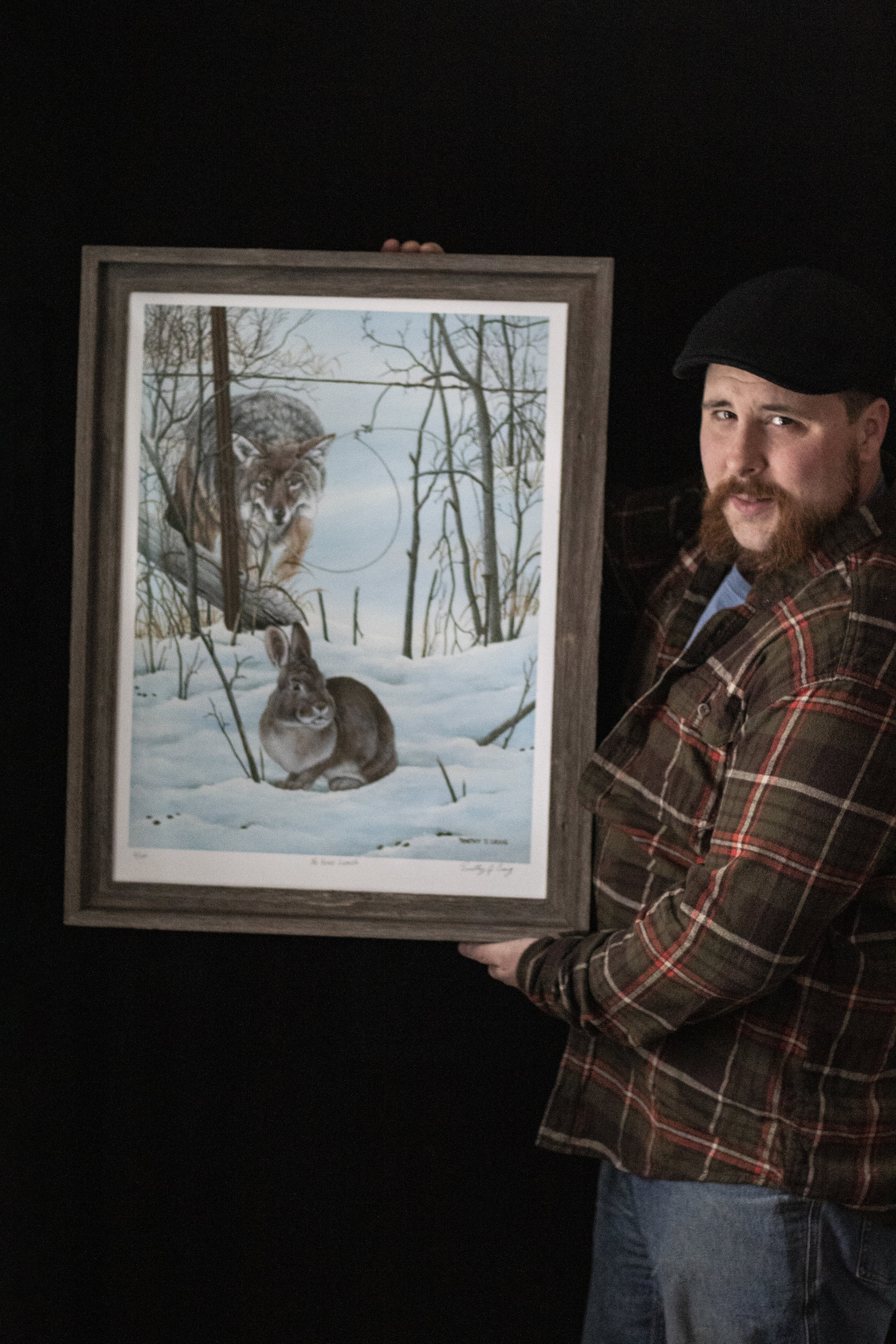 """The author with a signed print of """"No Free Lunch"""" by Timothy J. Craig (Photo 