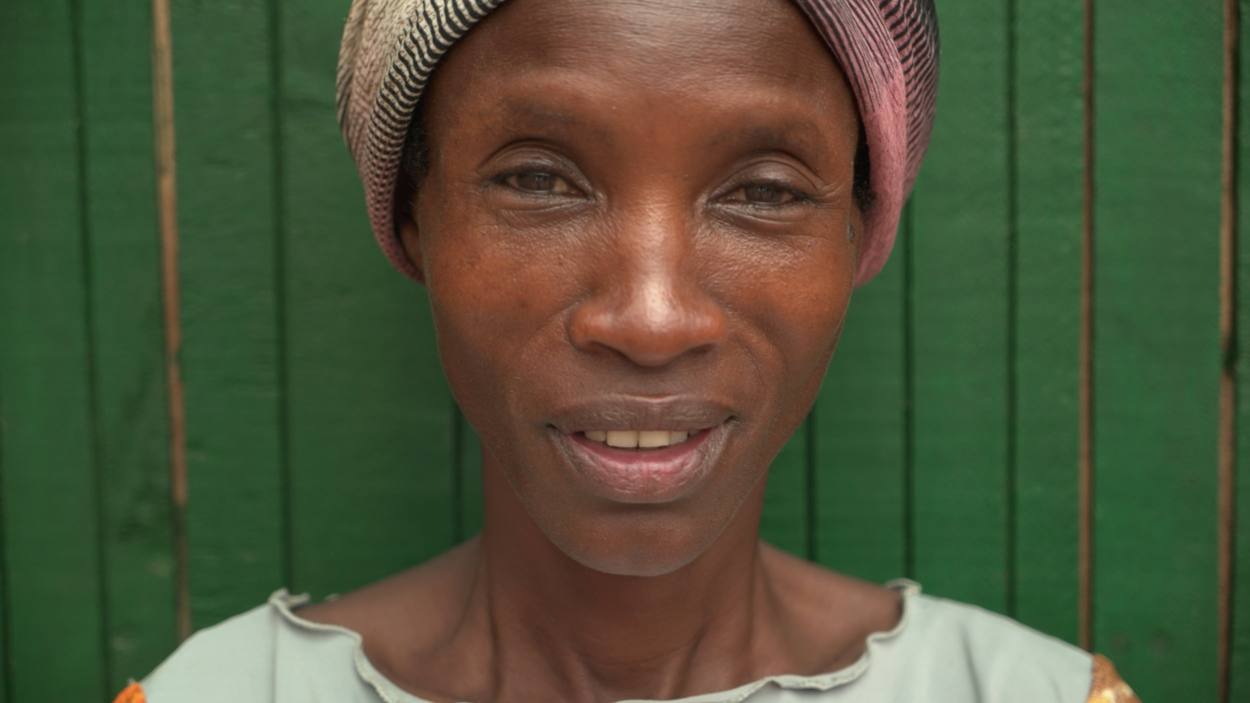 Jean - is 45 years old and has 4 children. She is the quiet type and usually gets all the pans greased and ready for the bread. When the bakery is not in operation she makes around $4 per month.