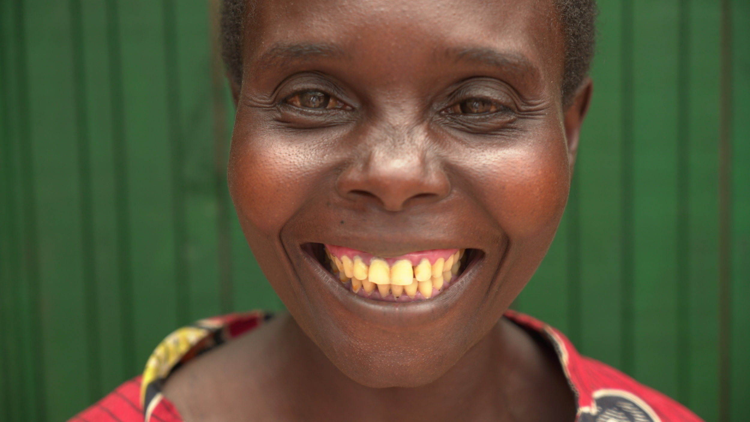 Liberata - is 30 years old and has 2 children. She might have trouble walking but she is skilled at ensuring the bread has a