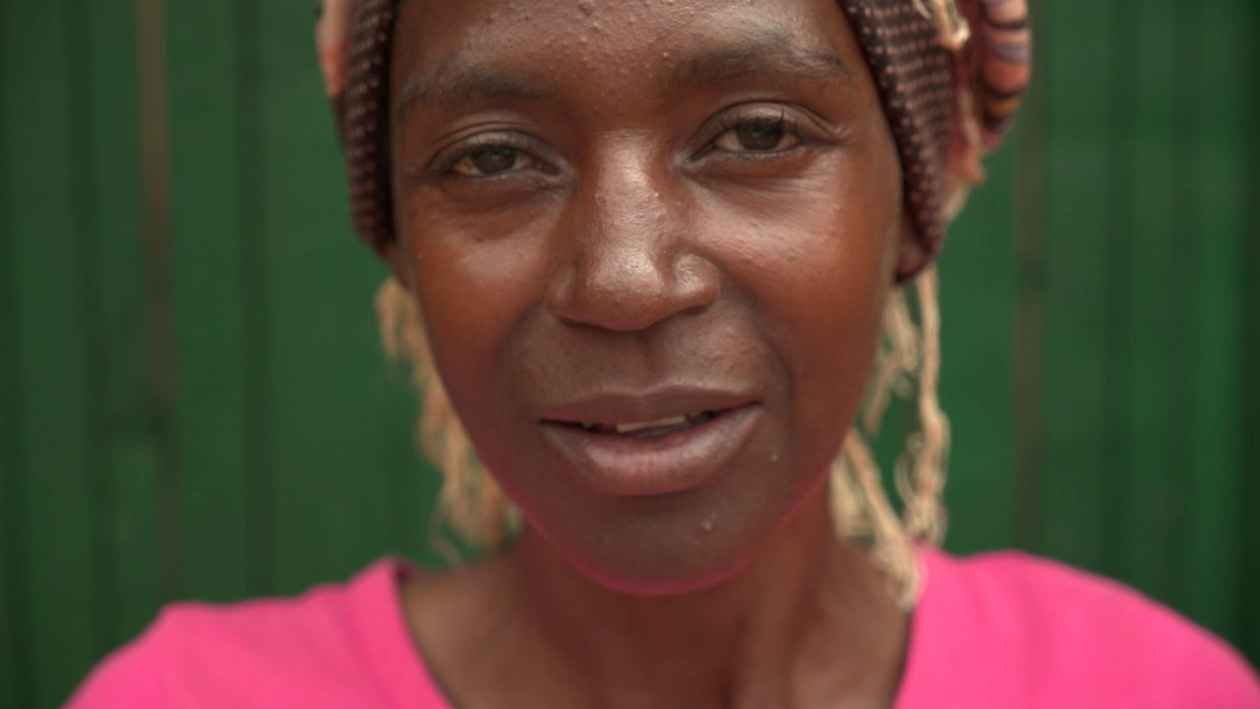 Goretti - is 51 years old and has 2 adopted children, who are genocide orphans. Goretti commutes one hour to the bakery and has been able to buy a pig for breeding with her earnings. When the bakery is not in operation she makes around $5 per month.