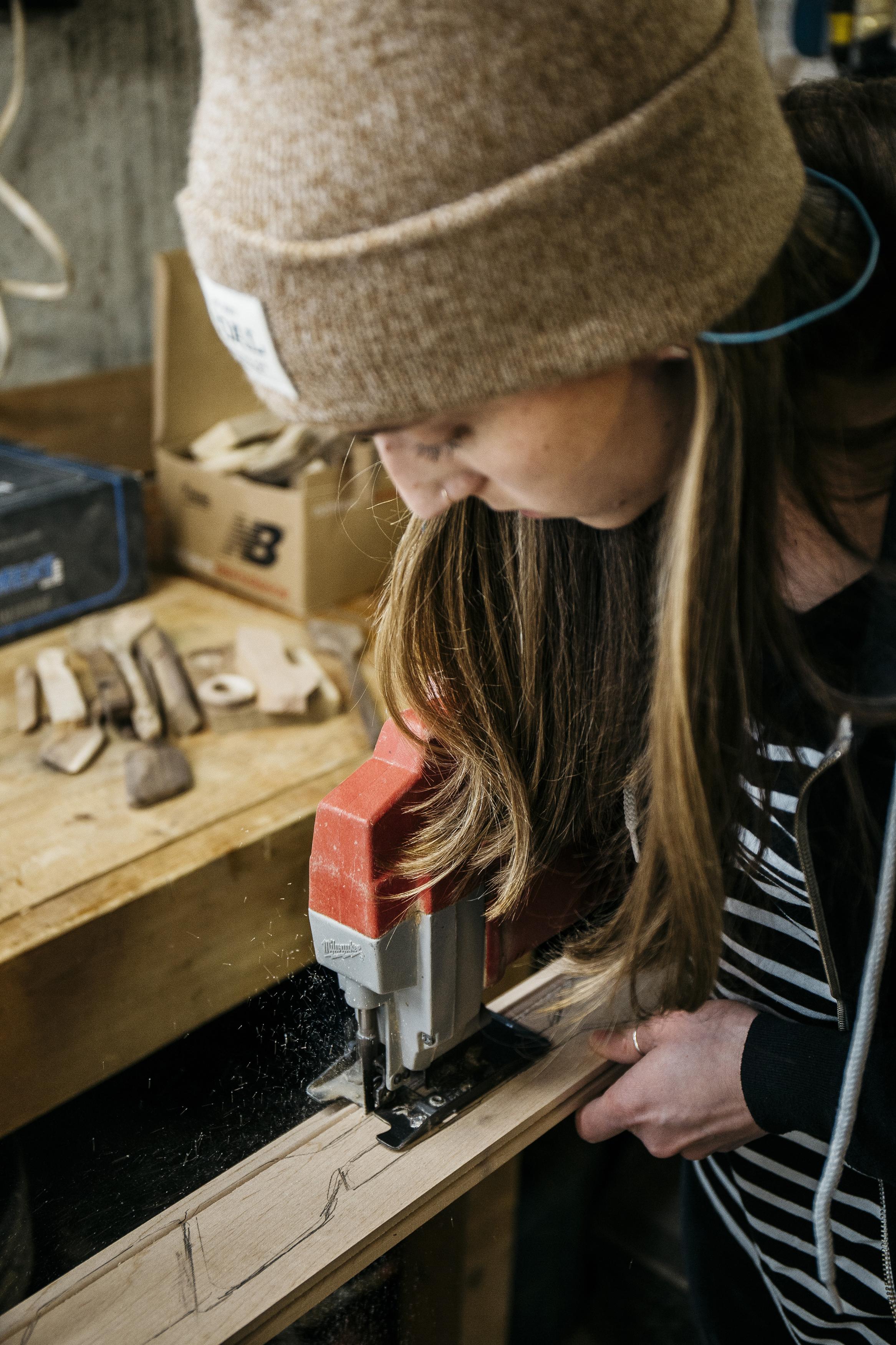 Step 1. Monika cuts out the spatula shape using an electric hand saw.