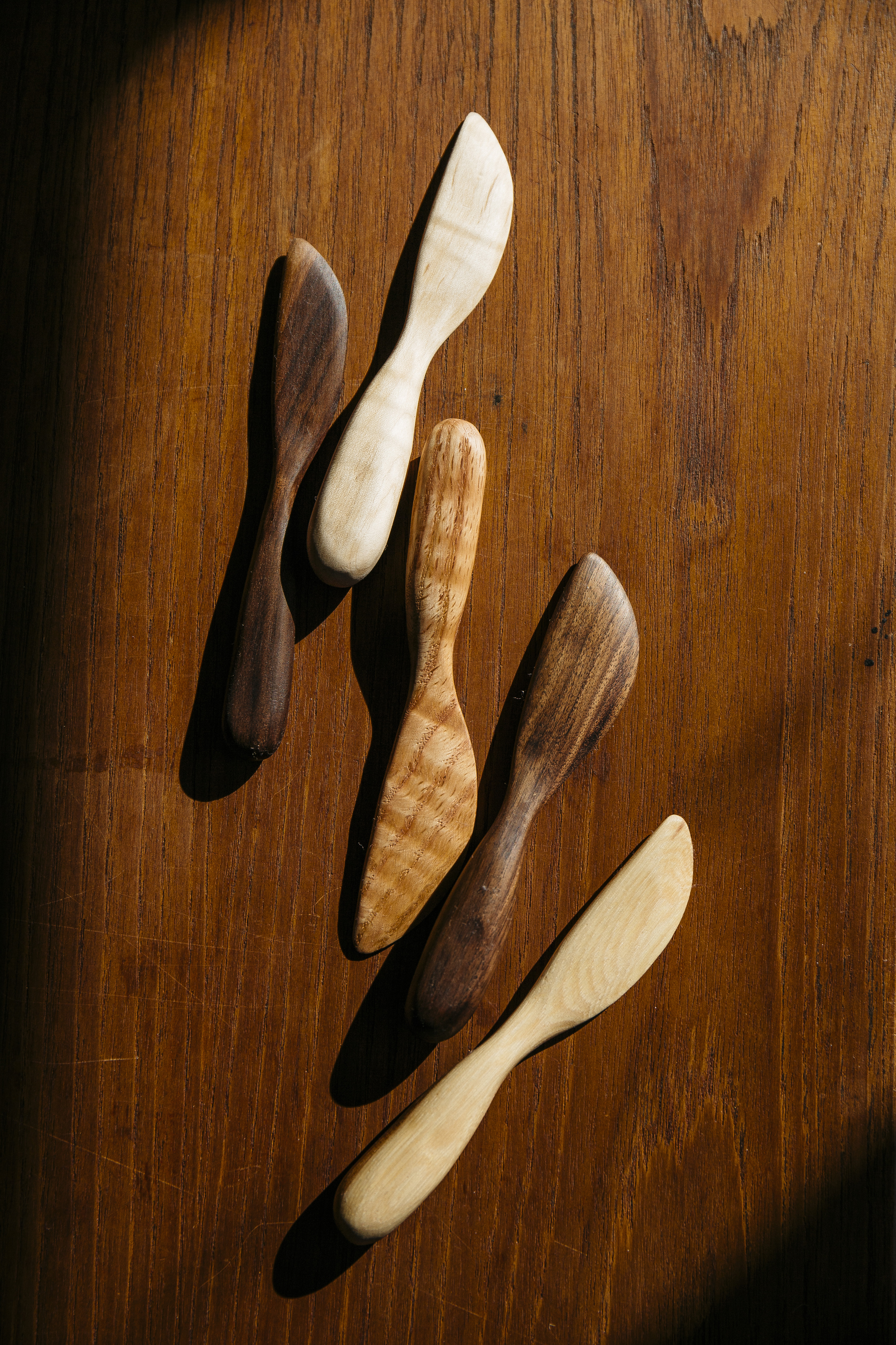 Boreal Design Co.  spreaders in walnut, oak and curly maple.