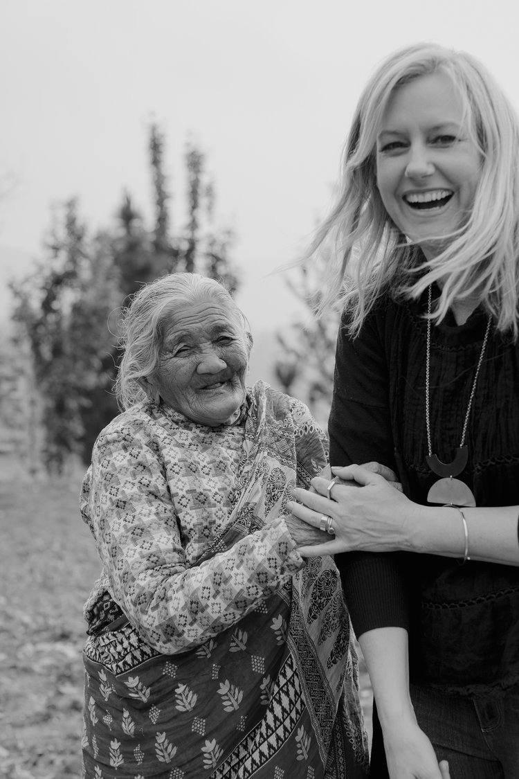 Tanja Cesh, on the right, laughs with a Nepali woman in her 90s who helps take care of all the women working at one of the fair trade felt factories MULXIPLY collaborates with to produce felt designs.