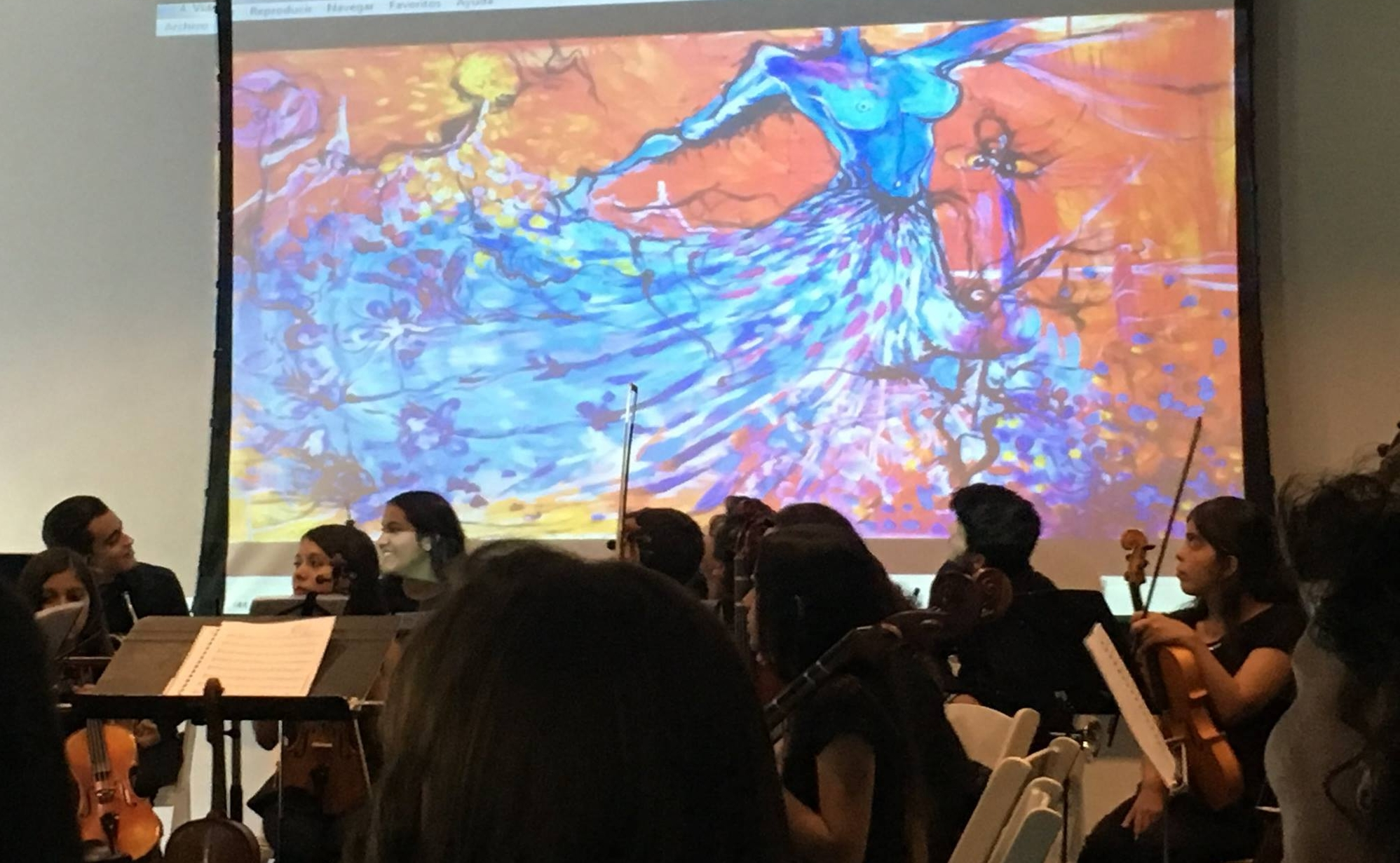 Siman Orchestra - Nicolle's art displayed during a performance of Siman Orchestral Foundation.