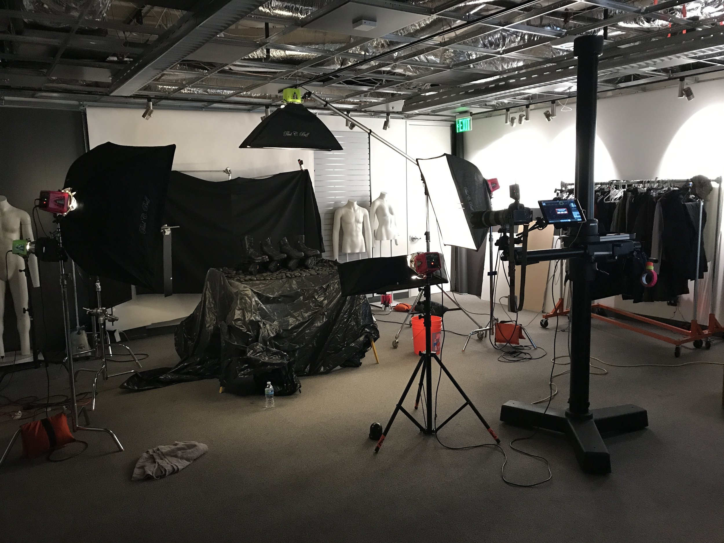 The setup was two medium softboxes (one on each side), one narrow box up front (turned way down) and one overhead narrow box, plus a kicker behind barndoors and flags on the left.