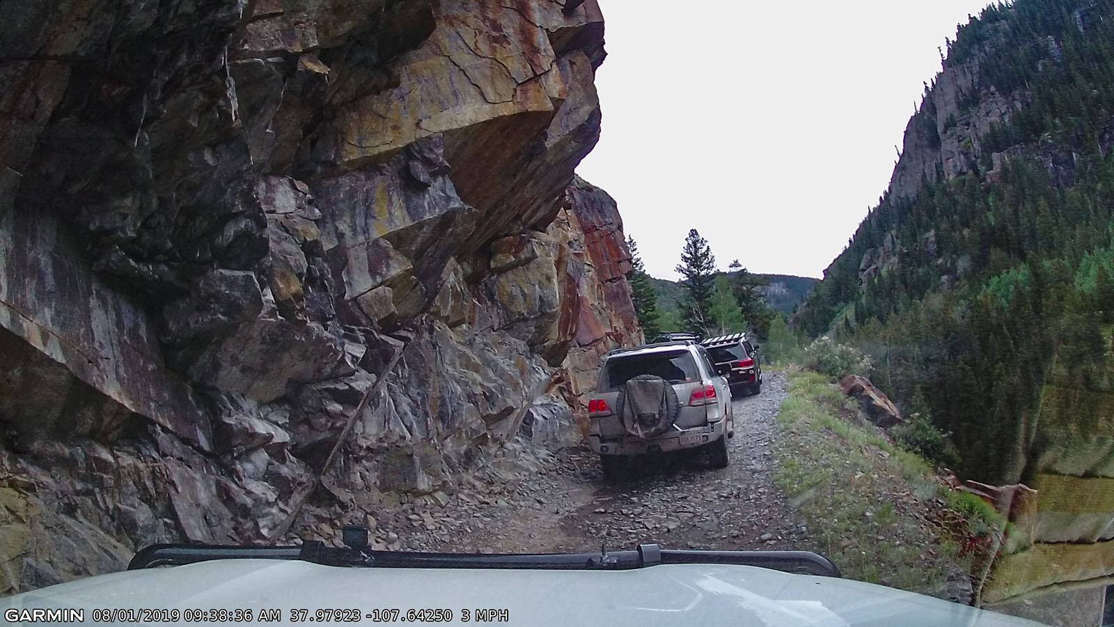 Garmin dash-cam shot showing the rock wall overhang and a peek at the downslope side.