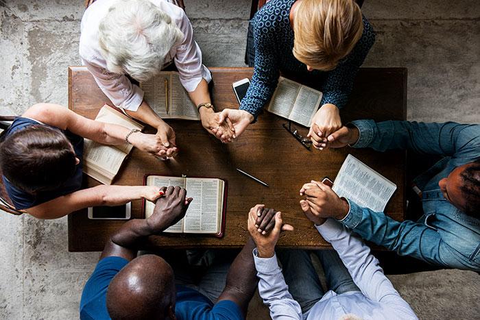 bible-st-multiethnic-people-holding-hands-bible-study.jpg