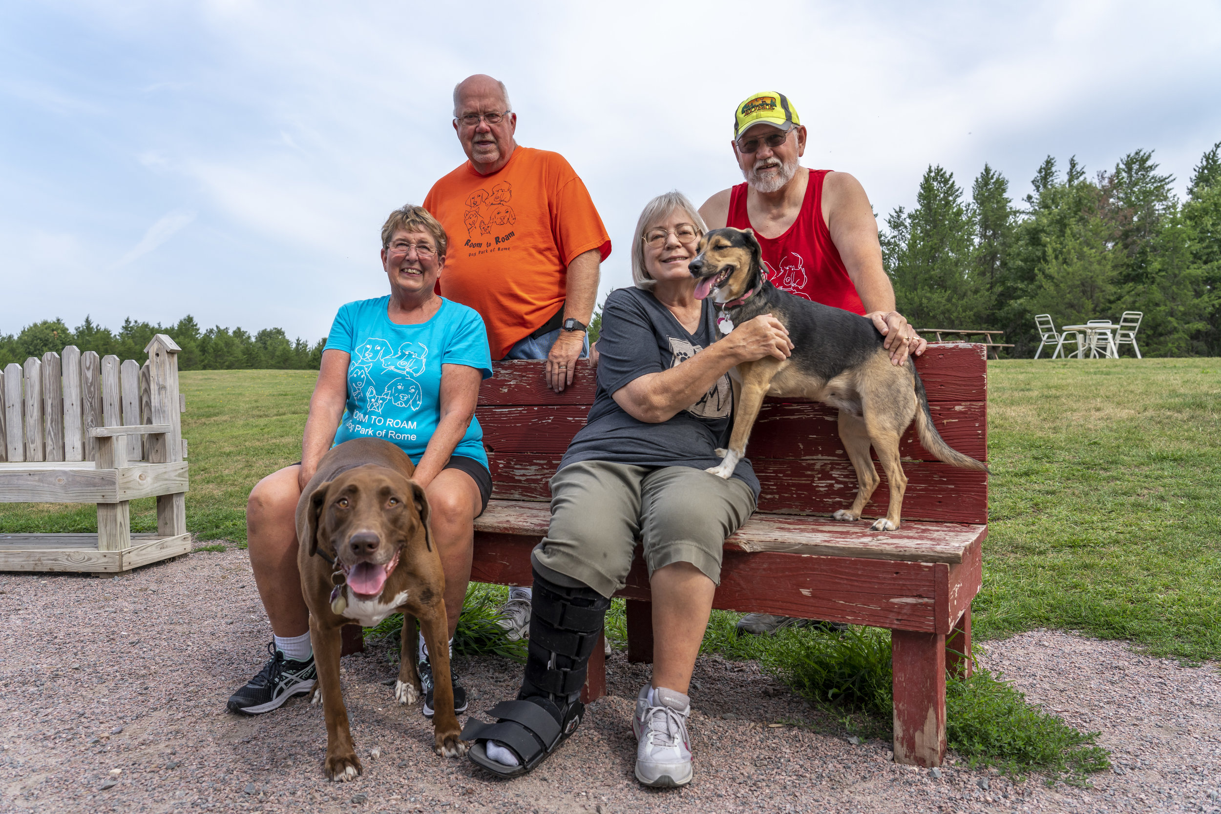 Founding Couple Kathy & Larry Halverson with fur baby Maizy on the left / Dog Park Volunteers Marge & Don Smith with fur baby Ellie on the right [ all images captured by Jeffrey Bertch of Links & Landscape Photography ]