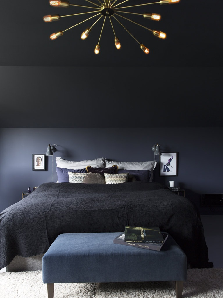 Dark colours make the space feel smaller and more intimate.