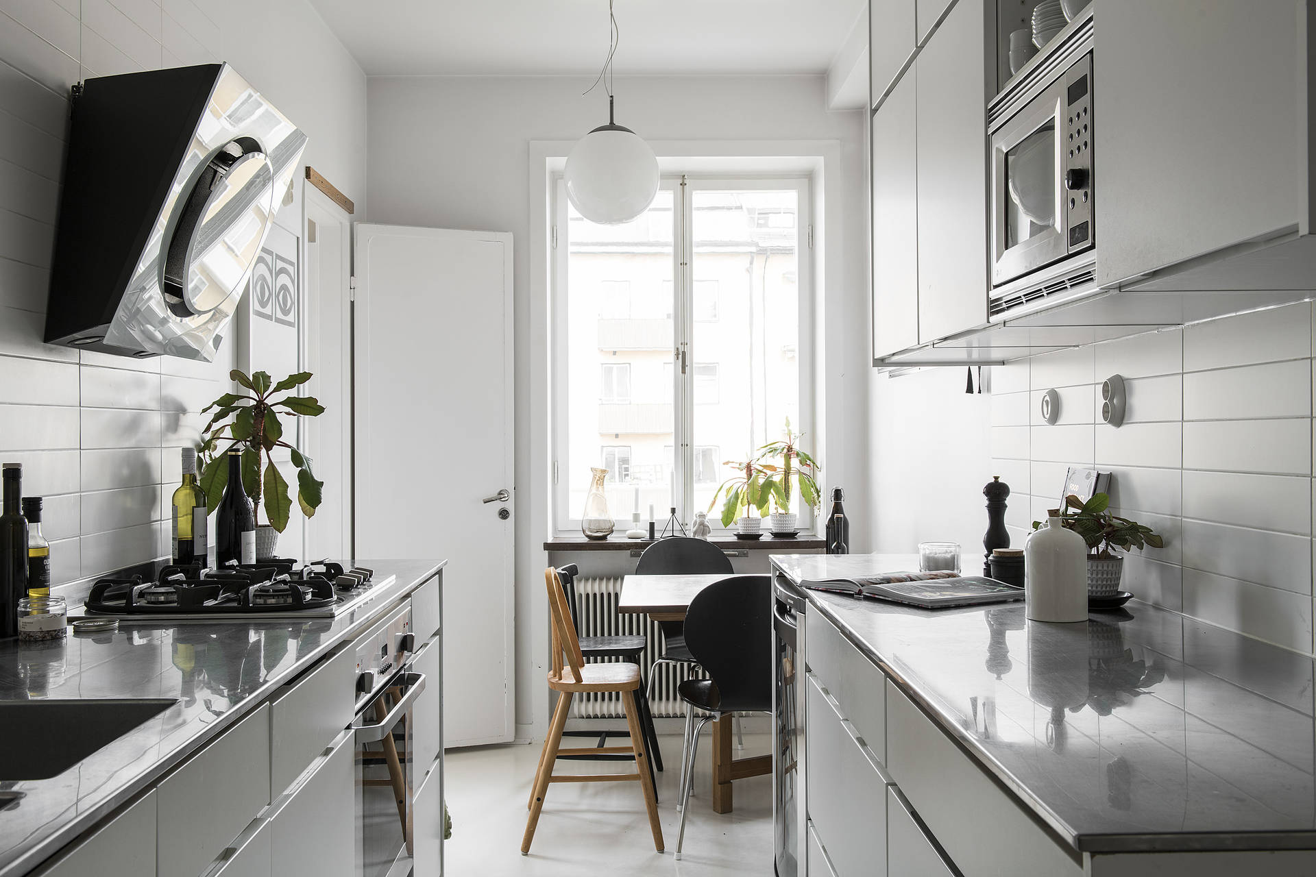The small space is utilized to perfection even adding a small breakfast corner.