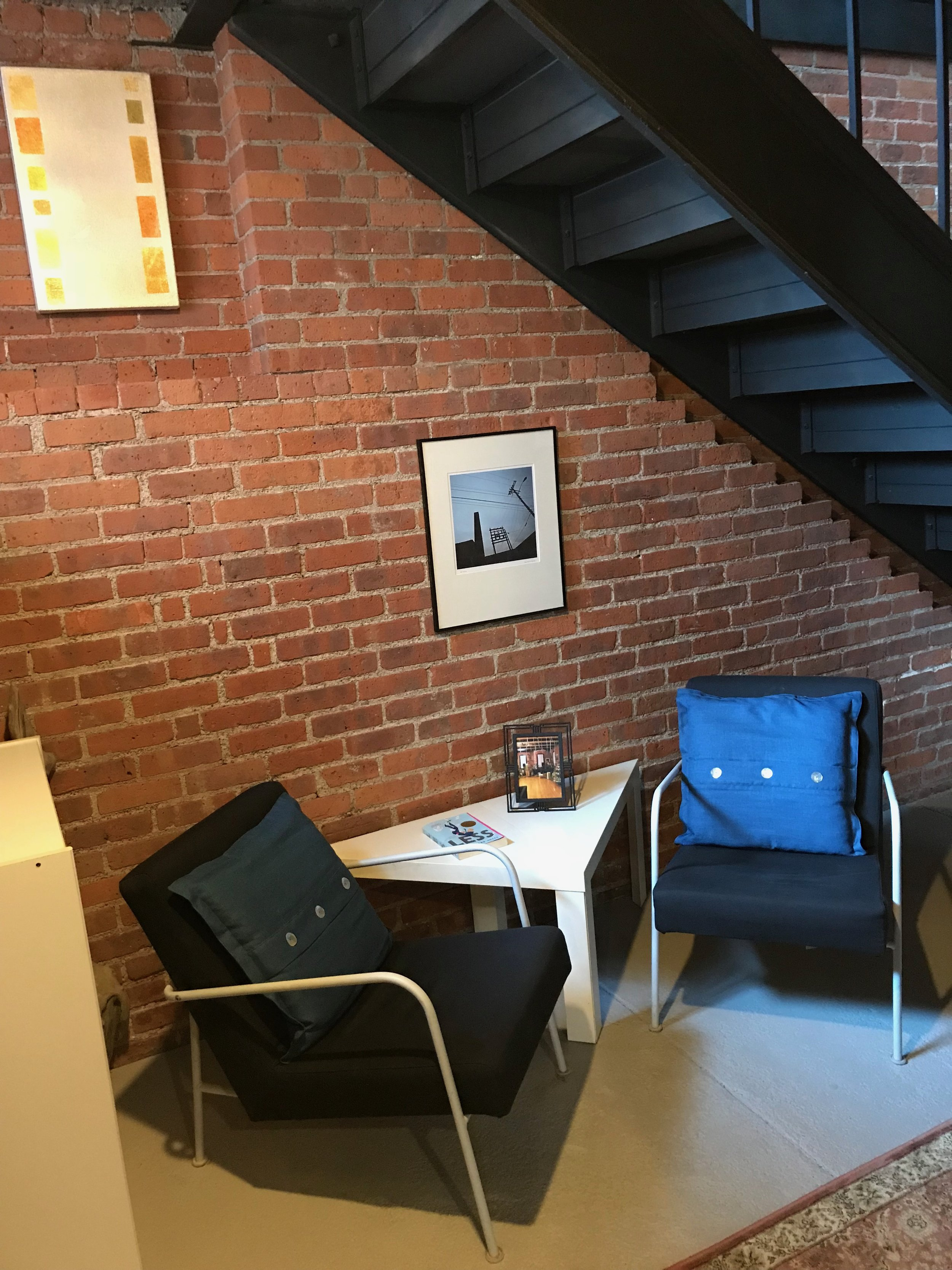 telelphone  building chair under stairs.jpg