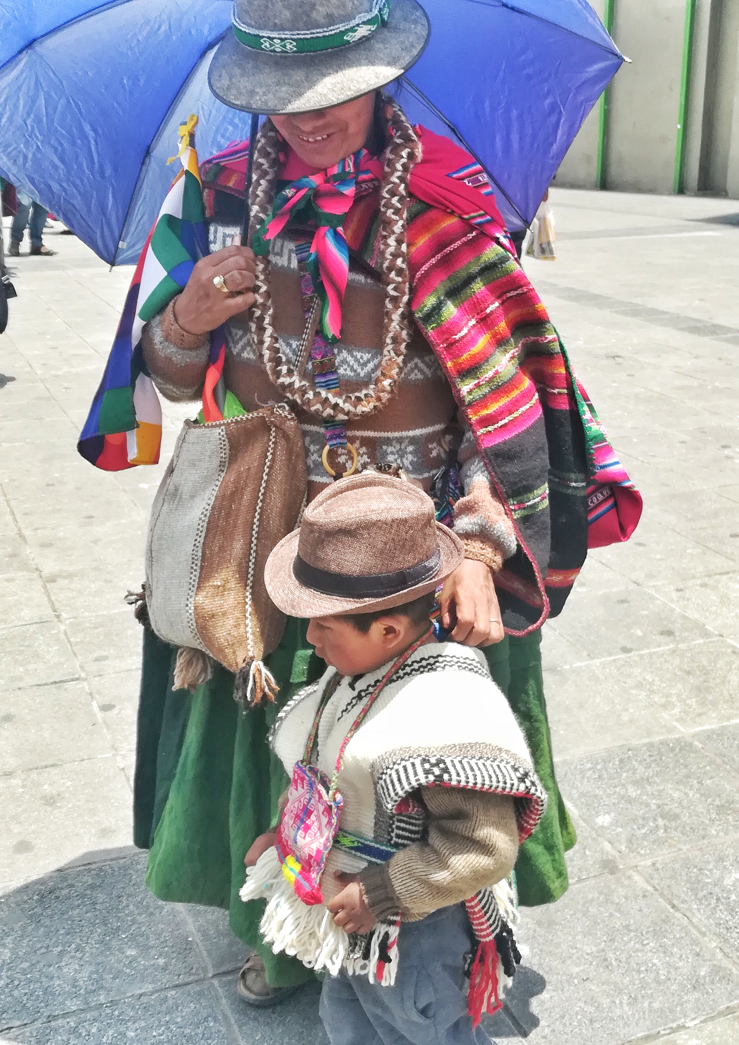 So many people still wearing the typical Bolivian getup! Loved it