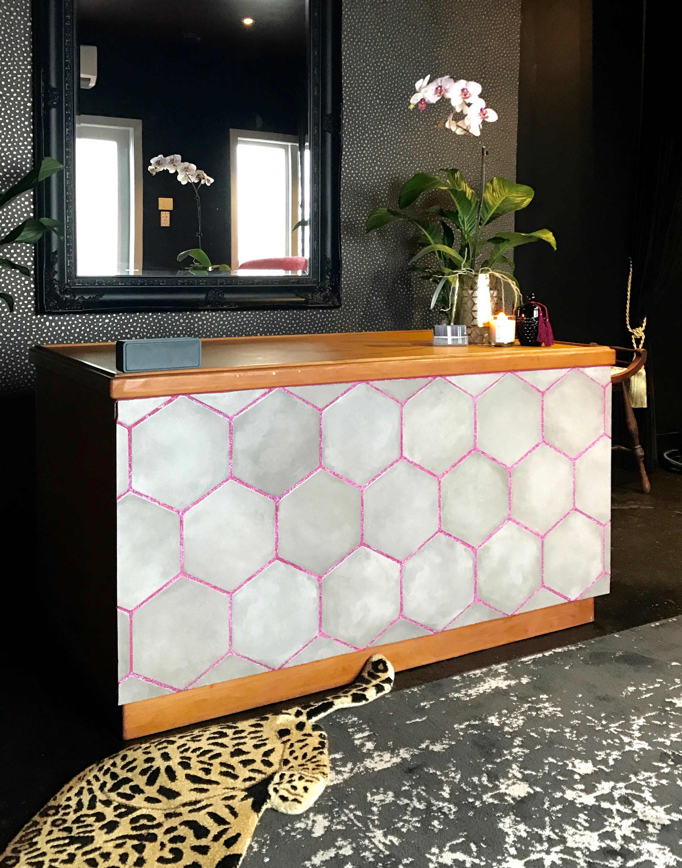 Old Rimu desk converted into stunning reception desk with hex tiles and pink glitter grout