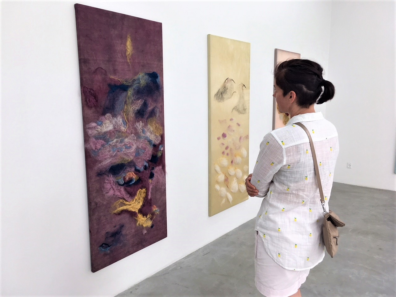 "Shannon Kaye, Director of Business Development, taking in silk and wool textile panels by  Julie Laenkholm  for her solo exhibition, ""The Unbearable Lightness of Being"" at  Eighteen Gallery  in the meat packing district of Copenhagen"
