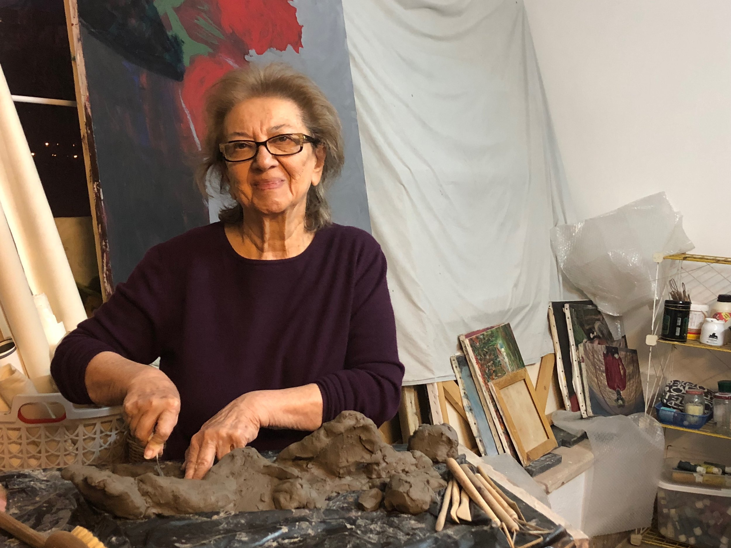 IAWF artist Guity Seif working in her studio
