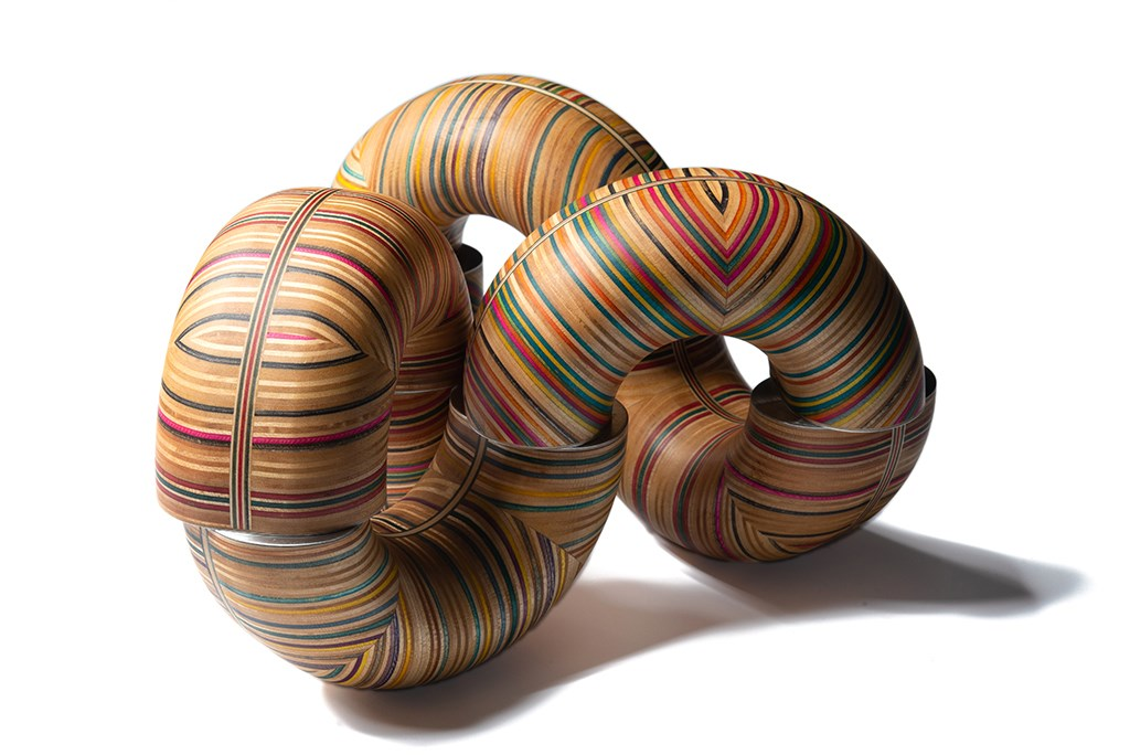 Big Mobius Donuts  by  Cedric Chevalley , Skateboard wood, aluminium, and magnets, 2018