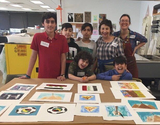 Nancy with small groups of local Houston Yazidi women, men, and children and their monotypes