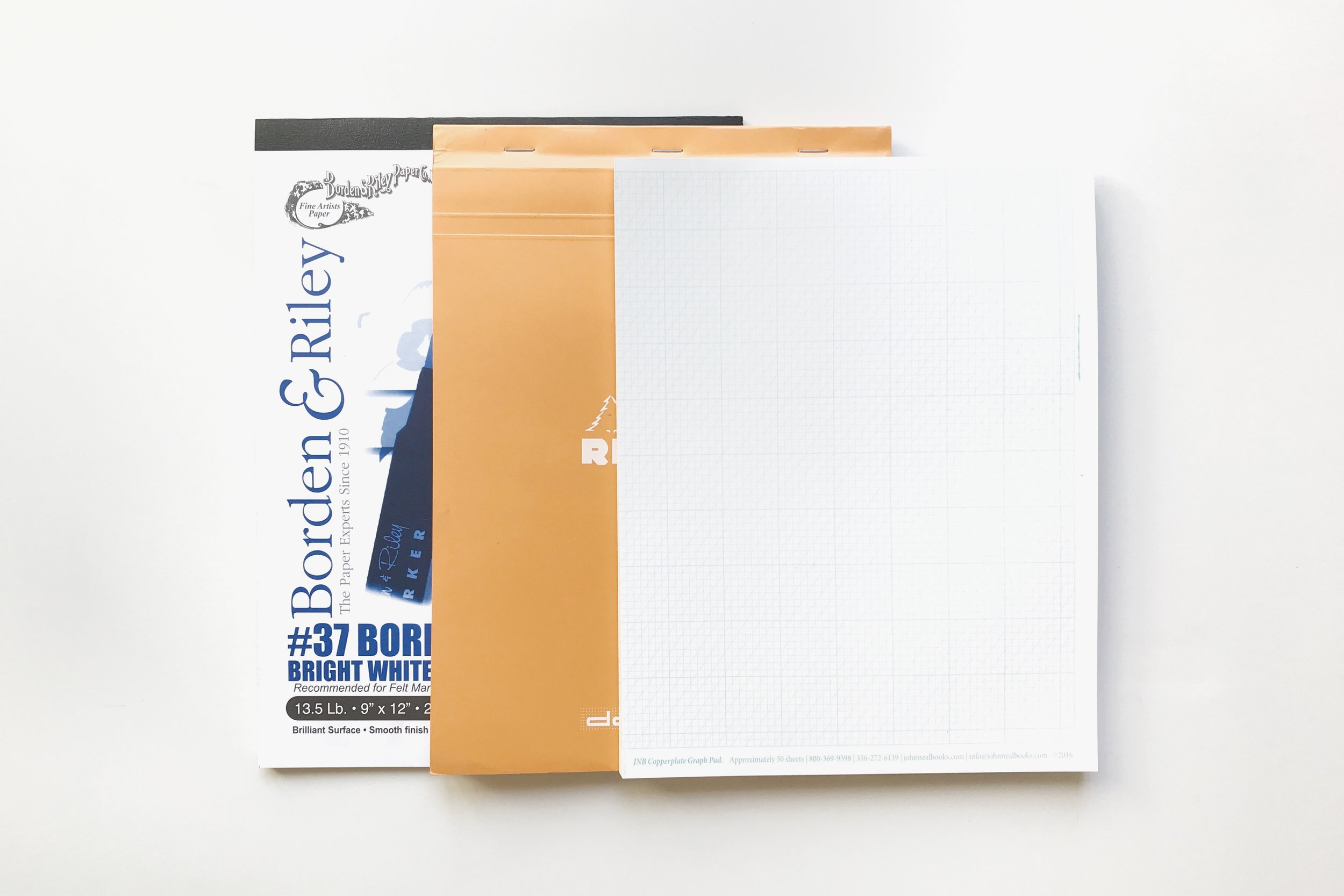 Paper Recommendations for Beginner Calligraphers   (from left to right):   Borden & Riley #37 Layout Paper ,  Rhodia Dot Paper ,  John Neal Books Copperplate Pad