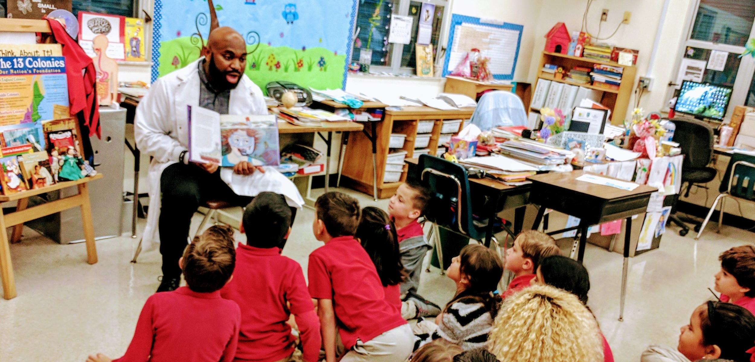 Maikel reading to elementary school children