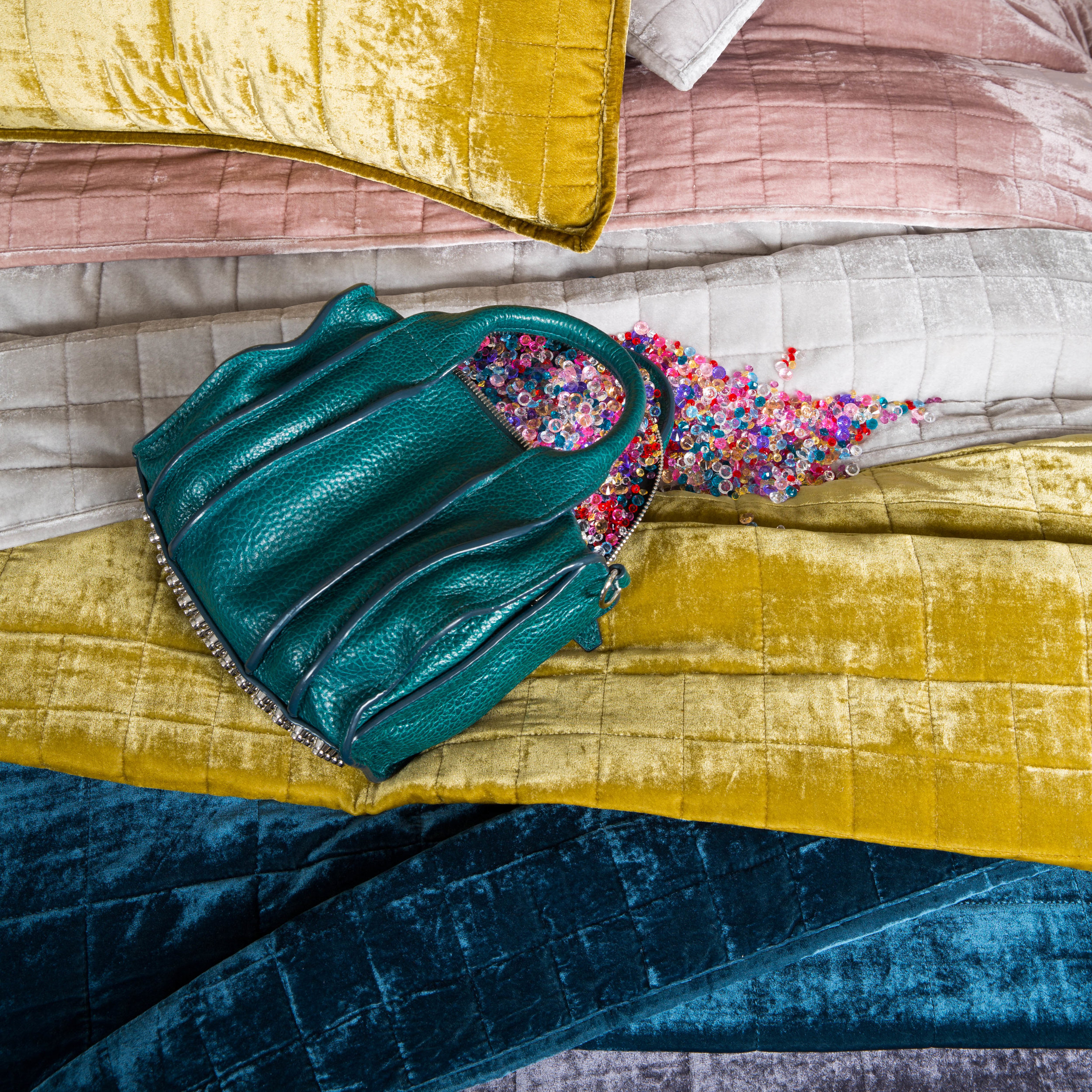 """BROOKE JACOBS  """"I loved the color of the bag and when I worked on a layered bed of rich velvety jewel toned blankets.I thought it would be perfect for the bag and I would go all out on the jewel concept. """""""