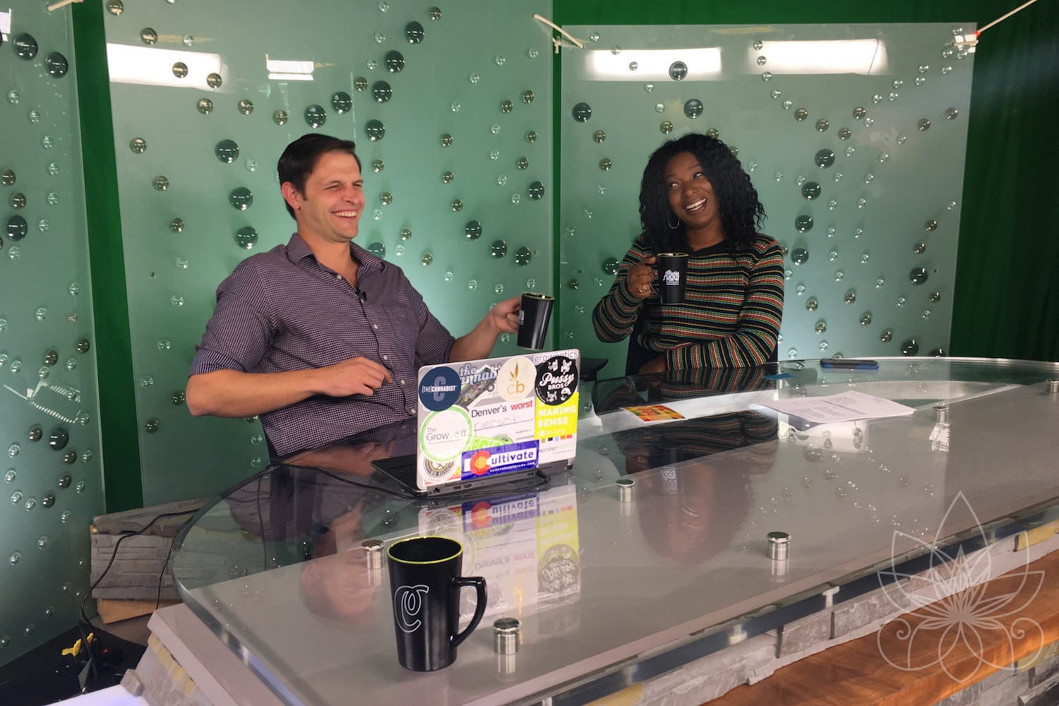 Jake Browne and Janae Burris at host desk for The Cannabist Show