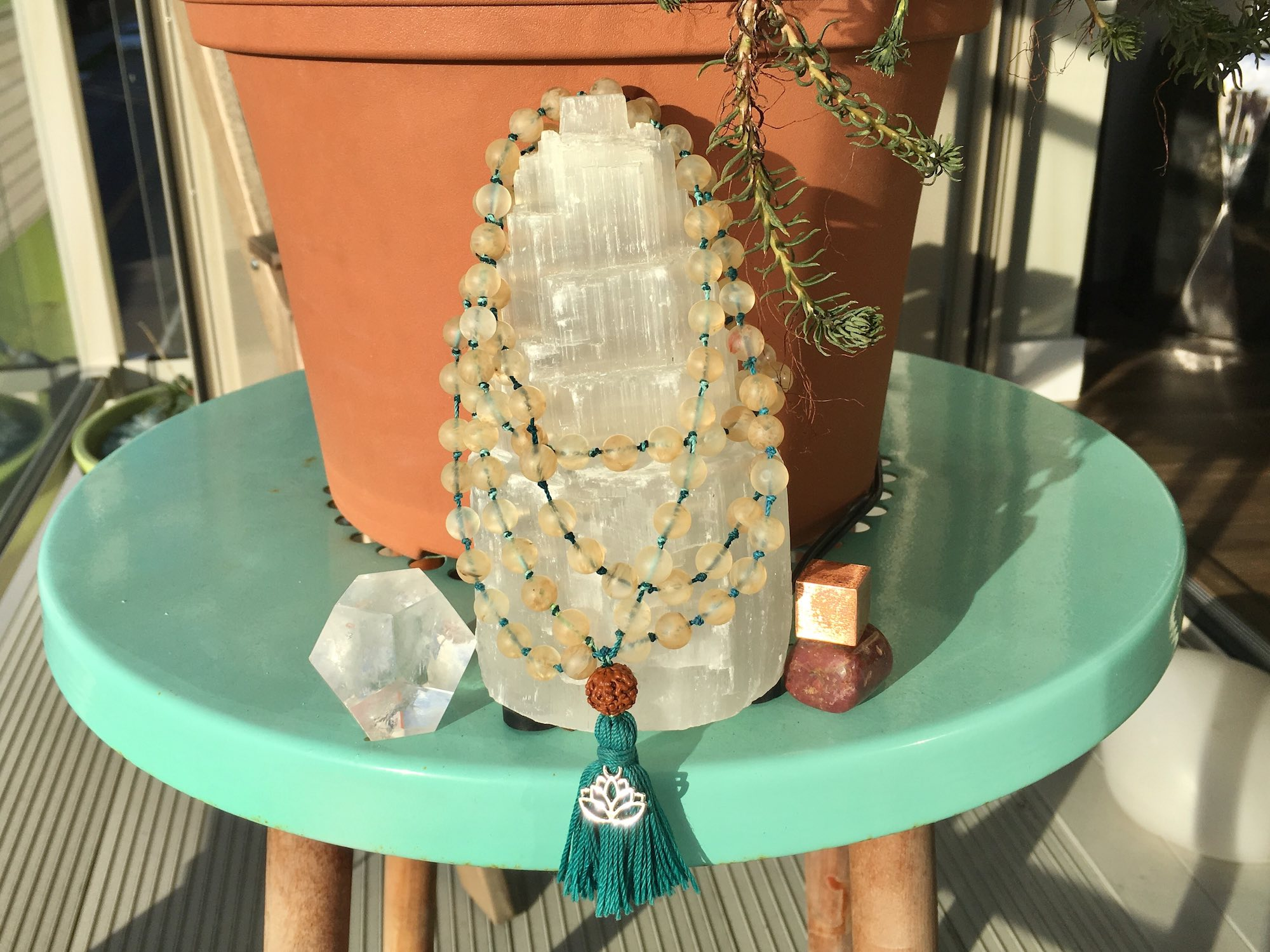 Make your own mala, the author, Stacey Mulvey's first mala that she made.