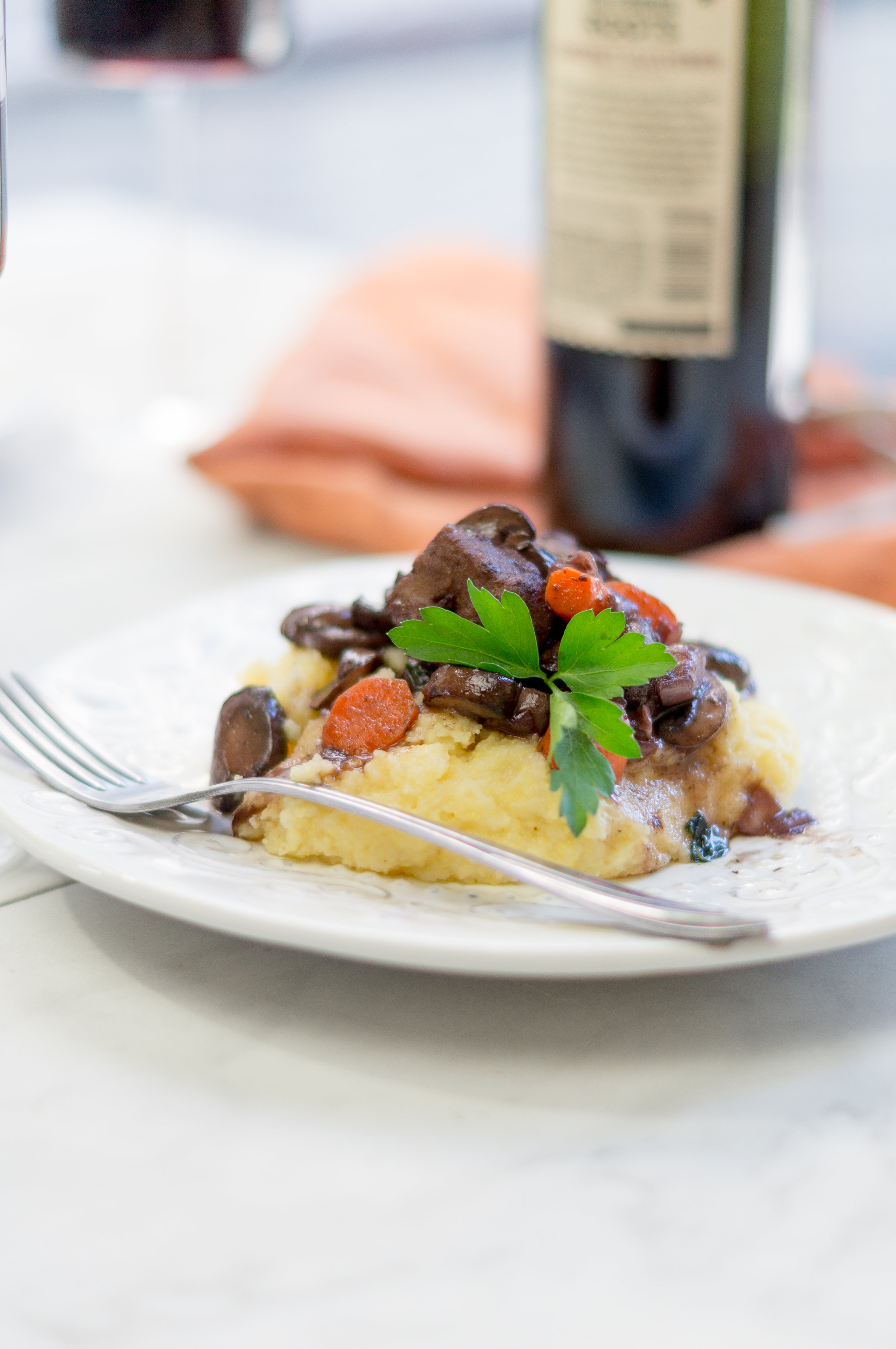 i am rorie, i am rorie recipes, whole foods, vegan food, vegan dinner, vegan stew, carrots, parsley, fresh parsley, salt, pink himalayan salt, garlic, polenta, vegan parmesan, vegan butter, parmesan, butter, vegan beef, beef tips, vegan beef tips, gardein beefless tips,shallot, cremini mushrooms, mushrooms, slurry, arrowroot flour, water, milk, almond milk, plant-based milk,wine, red wine, cooking with wine, wine in recipes, recipe using wine, hearty vegan recipe, vegan meal prep, winter meal prep, vegan winter meal prep, new year diet meal prep,chicago vegan blog, vegan blogger, vegan recipes, chicago blogger, food blogger, vegan food blogger, delicious vegan food, vegan health, vegan lifestyle