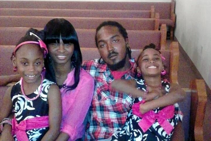 Gregory Vaughn Hill Jr. and Monique Davis, with their daughters Destiny (left), and Aryanna (right).