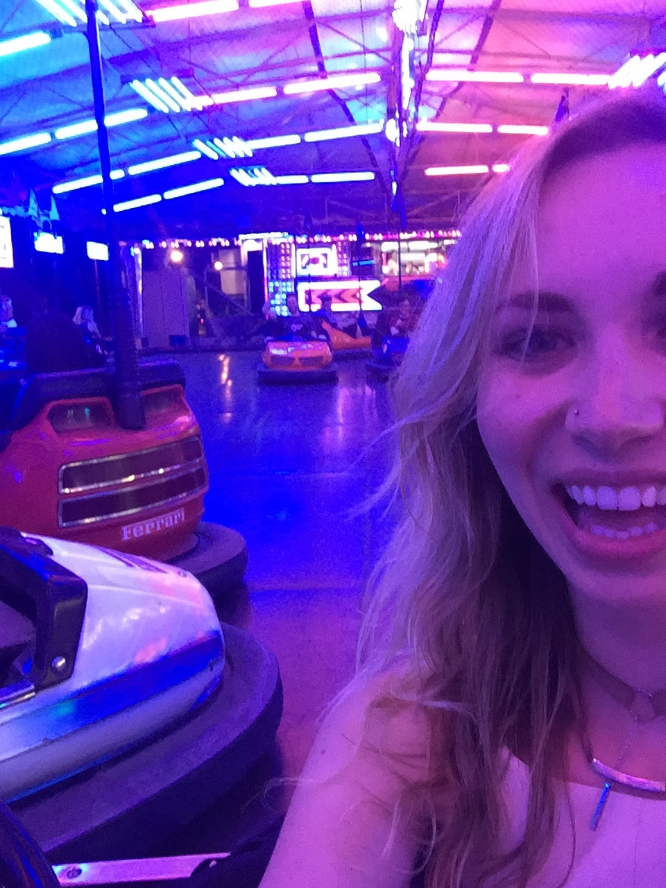 "Bumper cars at the Carnival, which is located in the Valencia ""river"" - a park that runs across the city where a river used to"