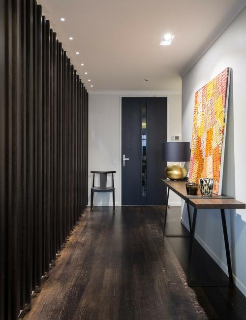 Art & lighting - Vibrant art and spot lighting guide the eye toward the entranceway.