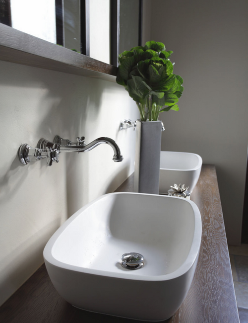 Cool tones - Simplicity is key in the master bathroom, with details like the antique design taps and modern basins combining old and new.